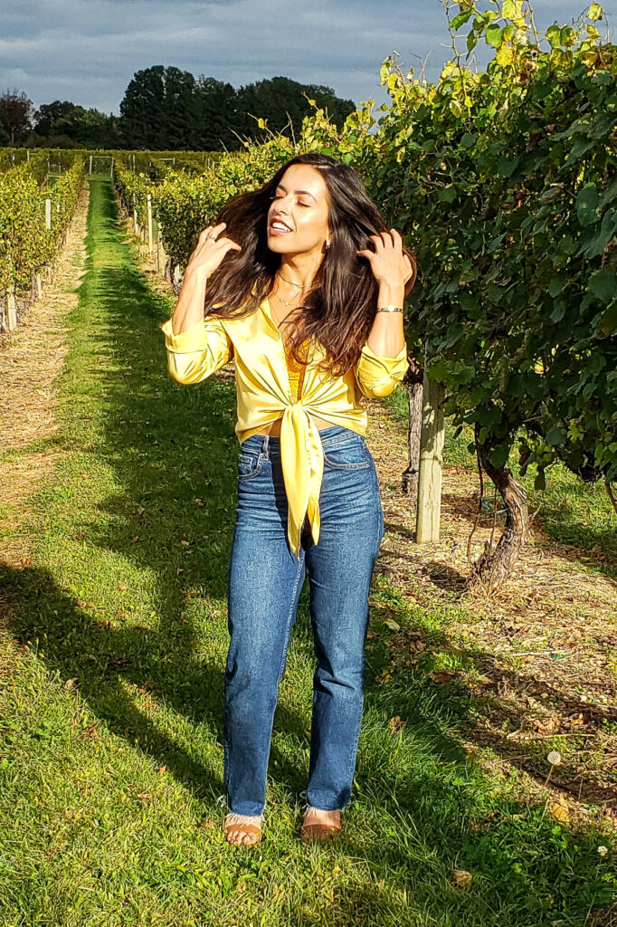 Blue jeans and a yellow crop top at the winery