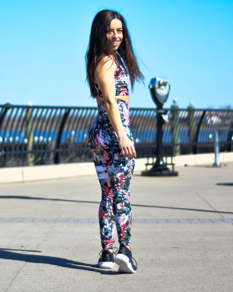 Woman at the boardwalk wearing a STRONGER Label activewear set